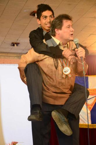 Pastor Jonatan Tejel carries a delegate to emphasize the weight of Goliath's armory during the hour of worship