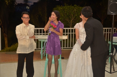"that awkward moment, my emcee partner, Tito Sherwin Fronda Fiedacan mandated us to mimic the newly wed; the modified one, ""beso-beso"" for the heiress of bouquet and heir of garter... THOU SHALL NOT REACT! haha!"