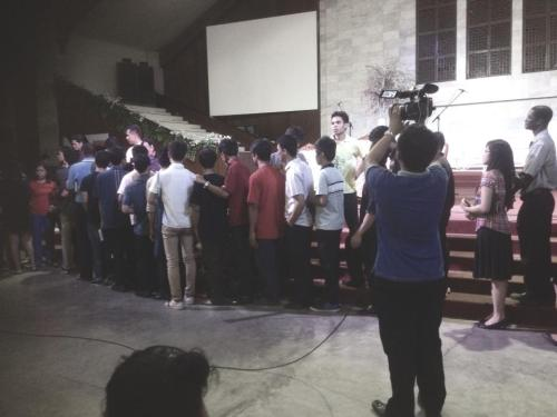 """AUP students lined up last night to hug and comfort the 15 survivors of Sunday's flood. The AUP family is here for you guys, as well as for the families of the three students who didn't make it. You are in our prayers."" #Godheals"
