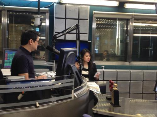 Jubilant Julius Babao facilitates the interview with co-host Ms. Niña Corpuz